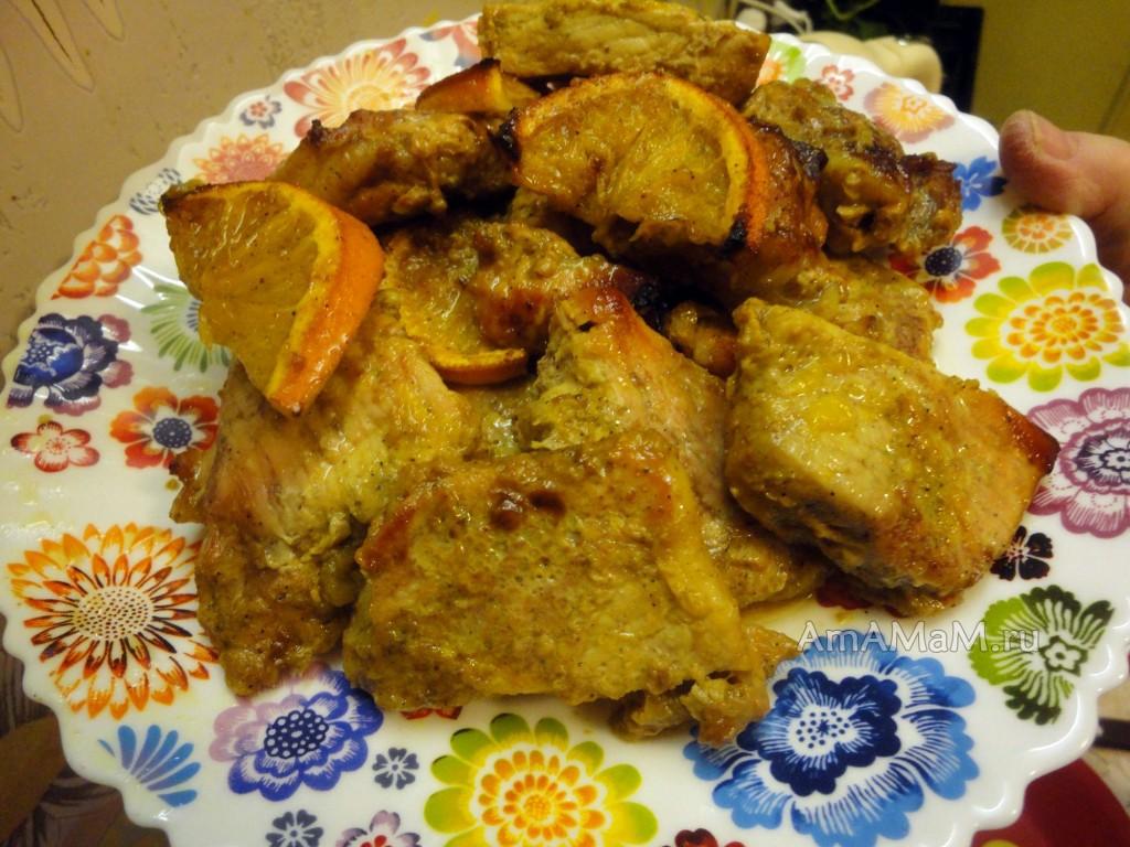 Свинина в духовке с апельсинами - рецепт