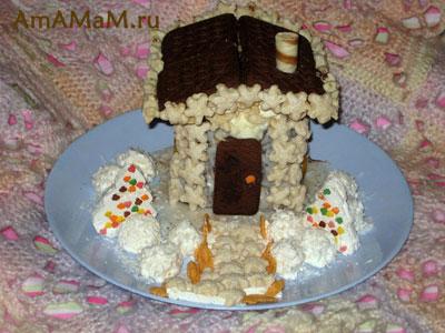 Изготовление новогоднего торта - домика ил обычного торта и украшений из зефира, печенья, вафельных трубочек и готовых завтраков