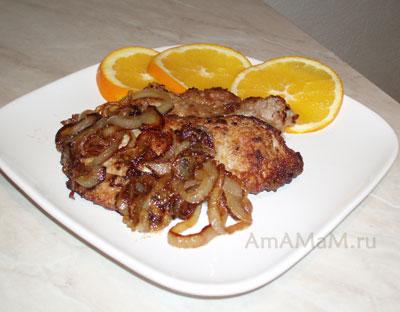 Очень вкусные свиные отбивные с карамельным луком и апельсинами