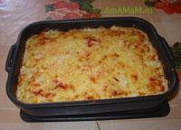 Запеканка с пельменями под сметаной, майонезом и сыром